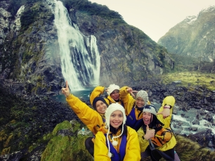 The kayak crew in Lady Bowen Falls, Milford Sound, New Zealand